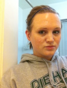 Here's me...in a sweatshirt...without makeup...trying to smile through a mask.